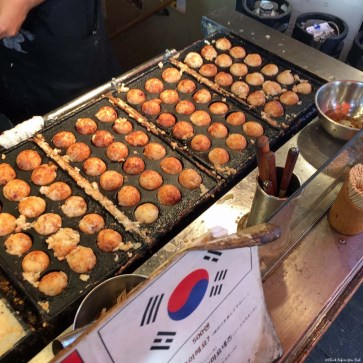 Warming up the Octopus Balls before serving - Osaka, Japan