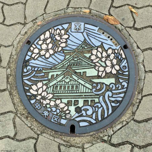 Manhole cover with drawing of Osaka Castle - Osaka, Japan