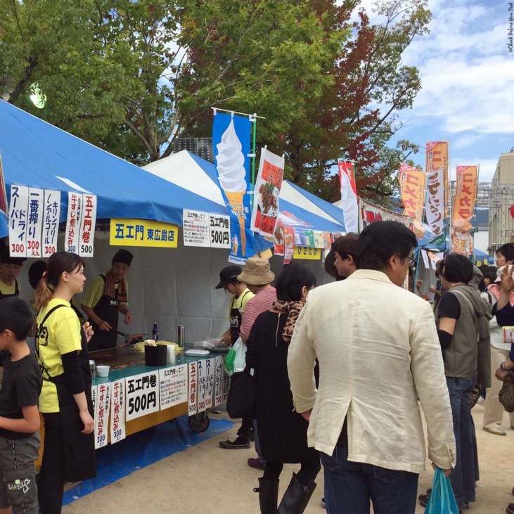 Food vendors within the outdoor izakaya - Saijo, Japan