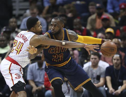 Cleveland Cavaliers forward LeBron James (23) works against Atlanta Hawks forward Kent Bazemore (24) during the first half of an NBA basketball game Friday, April 1, 2016, in Atlanta. (AP Photo/John Bazemore)