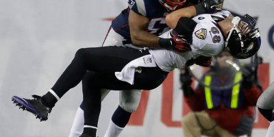 Baltimore Ravens tight end Dennis Pitta (88) is tackled by New England Patriots outside linebacker Jerod Mayo (51) during the second half of the NFL football AFC Championship football game in Foxborough, Mass., Sunday, Jan. 20, 2013. (AP Photo/Elise Amendola)