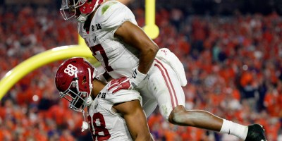 Alabama Crimson Tide tight end O.J. Howard (88) celebrates with running back Kenyan Drake (17) after scoring a touchdown during the NCAA College Football Playoff National Championship game against the Clemson Tigers on Monday, Jan. 11, 2016, in Glendale, Ariz. (Ric Tapia via AP)