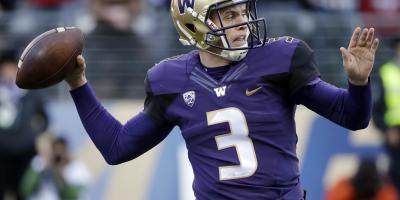 Washington quarterback Jake Browning drops back to pass against Washington State in the first half of an NCAA college football game Friday, Nov. 27, 2015, in Seattle. (AP Photo/Elaine Thompson) ORG XMIT: WAET109