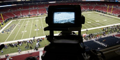 ORG XMIT: NY188 ADVANCE FOR WEEKEND EDITIONS, SEPT. 3-4 - FILE - In this Sept. 26, 2010, file photo, a television camera is seen high over the field before the start of an NFL football game between the Washington Redskins and St. Louis Rams in St. Louis. The NFL was already a highly valuable property when the league signed new TV deals starting in 2006 that have it currently bringing in about $4 billion a year. But since then, the gap between the average viewership for NFL games and everything else on TV has grown markedly. The revenue pie distributed by the new collective bargaining agreement could be much bigger in a few years. (AP Photo/Jeff Roberson, File)