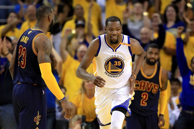 OAKLAND, CA - JUNE 01:  Kevin Durant #35 of the Golden State Warriors reacts to a play against the Cleveland Cavaliers in Game 1 of the 2017 NBA Finals at ORACLE Arena on June 1, 2017 in Oakland, California. NOTE TO USER: User expressly acknowledges and agrees that, by downloading and or using this photograph, User is consenting to the terms and conditions of the Getty Images License Agreement.  (Photo by Ezra Shaw/Getty Images)