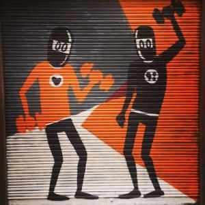 David Limón ninja street art with dumbells