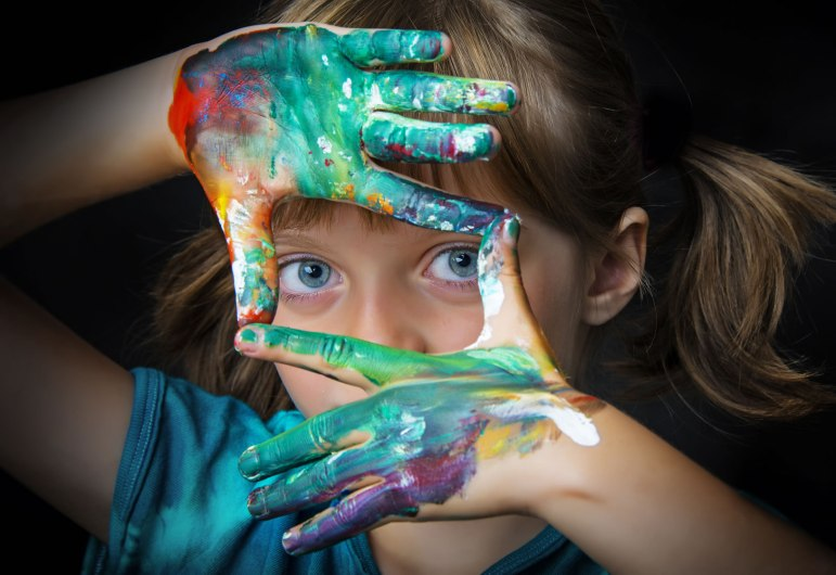 Girl with messy finger paint
