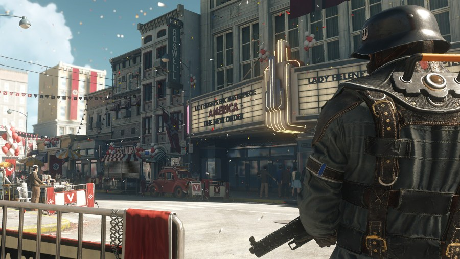A street in Wolfenstein 2, a soldier stands to the right wearing armour and holding a gun