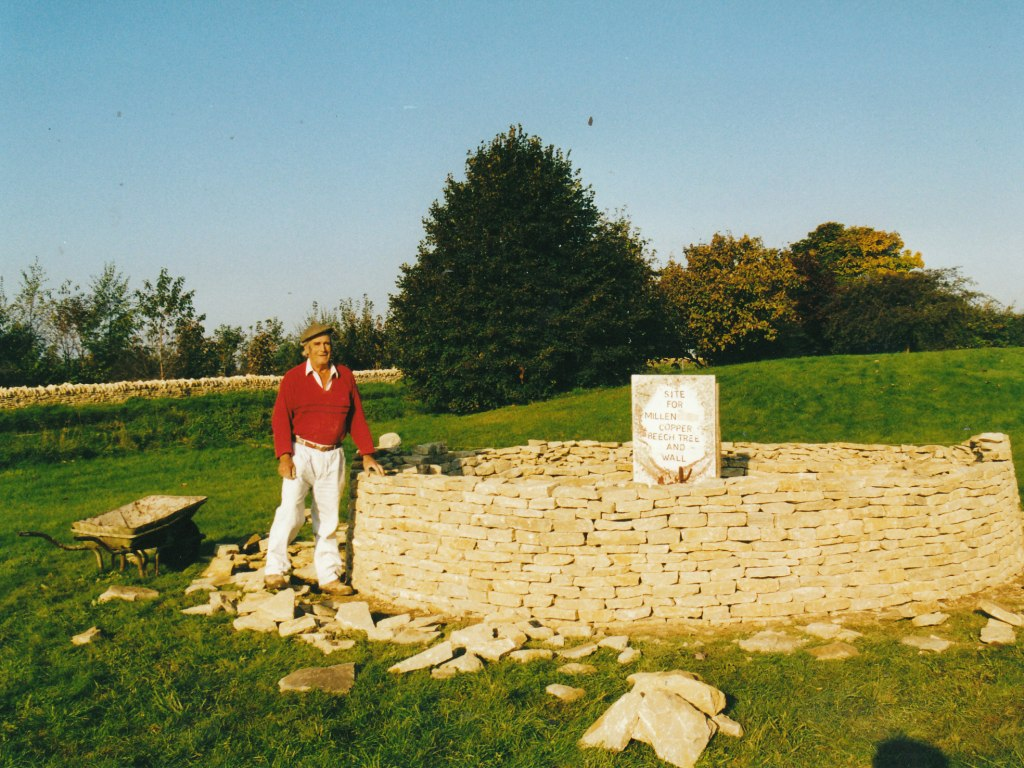 Front of Chedworth Village Hall. Tony Baxter building the Millennium circular wall in the front ground of the Chedworth Village Hall October 1999.