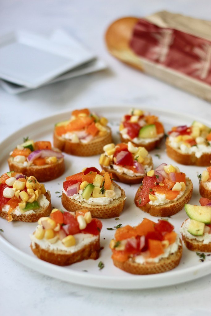 This Farmers Market Vegetable Bruschetta is the perfect party appetizer, side dish, or colorful meal. Customize it your way to make it gluten-free, dairy-free, or vegan! #seasonal #summerveggies #bruschetta #farmersmarket #CheerfulChoices