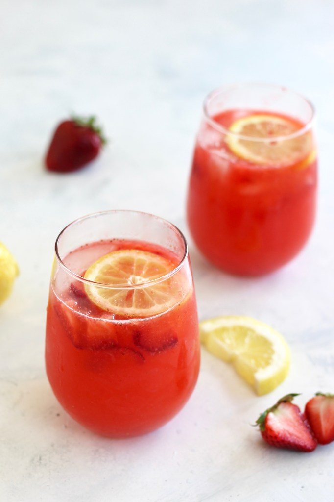 This Spiked Strawberry Lemon Spritzer is naturally flavored from seasonal strawberries and freshly squeezed lemons. Unlike most cocktails, this drink has sugar-free + low-sugar options and has less than 100 calories per drink. #healthycocktail #summerdrinks #sugarfree #strawberryrecipes #CheerfulChoices