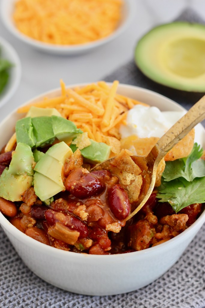 In this Customizable Chili Recipe Template you get to choose your favorite meat, vegetables, beans, and toppings. You can meal prep this chili ahead of time too! #Chili #RecipeTemplate #Customize #GlutenFree #OnePot #MealPrep #Crockpot
