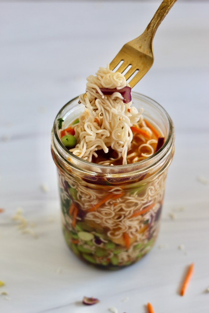 Gold fork full of ramen noodles