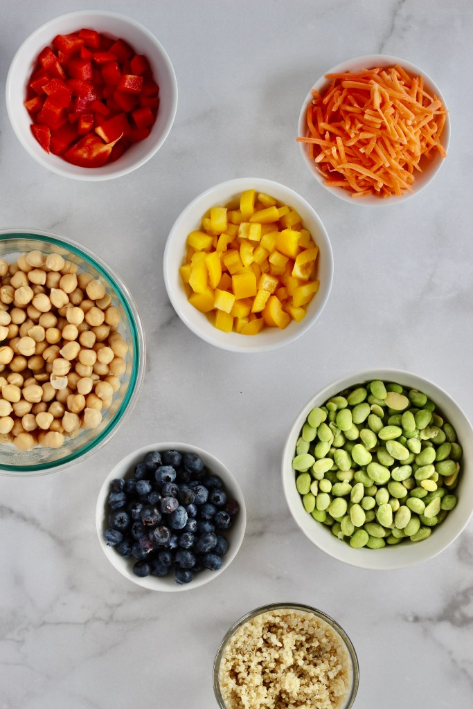 Colorful ingredients measured out in small white bowls