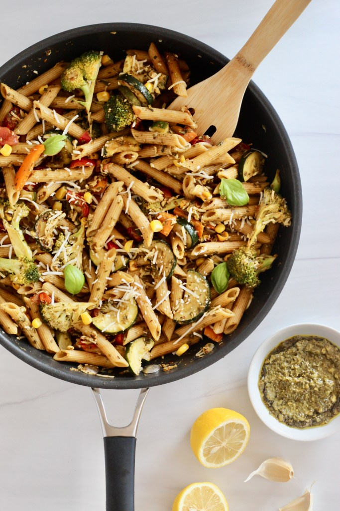 Penne pasta and vegetables in a large pan