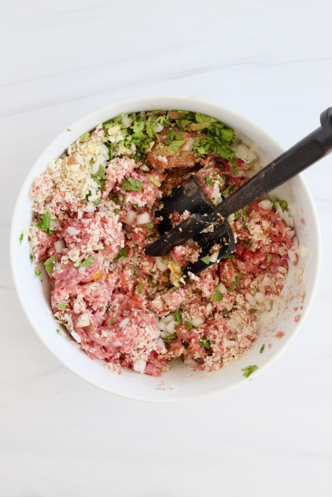 Ground lamb mixture in a white bowl