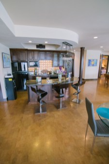 Wide view of kitchen and chairs