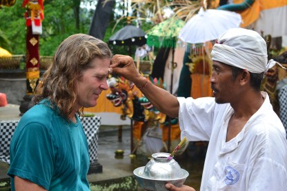 Darrell getting blessing after making a donation to the temple