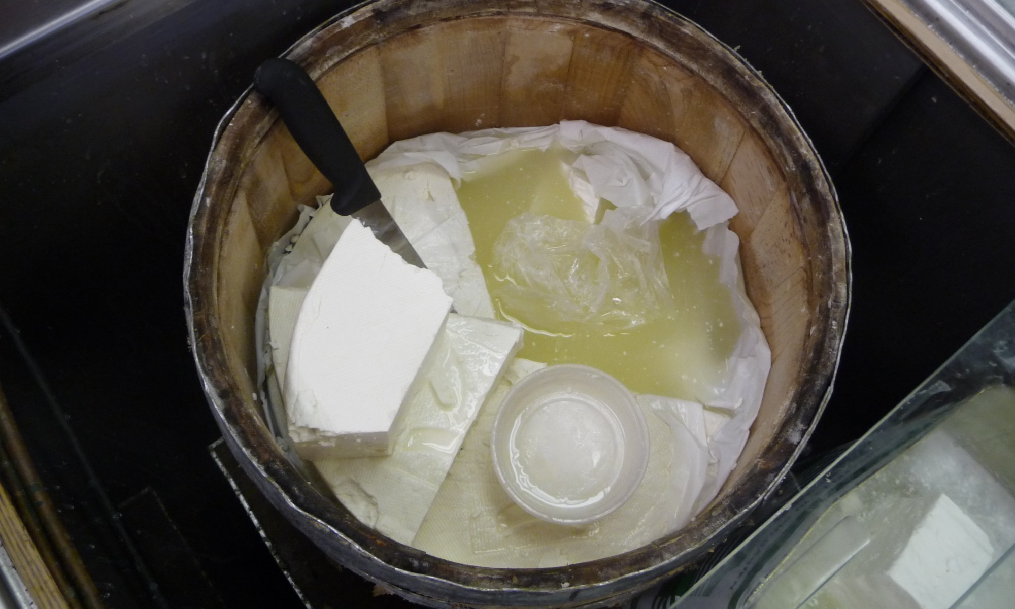 Mediterranean Store, Vancouver Canada, barrel of Feta in brine without cover.