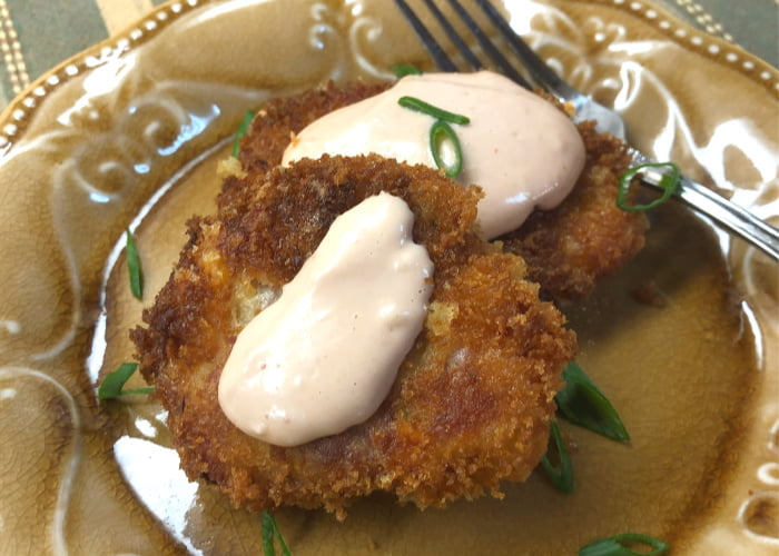 Two fritters on a plate