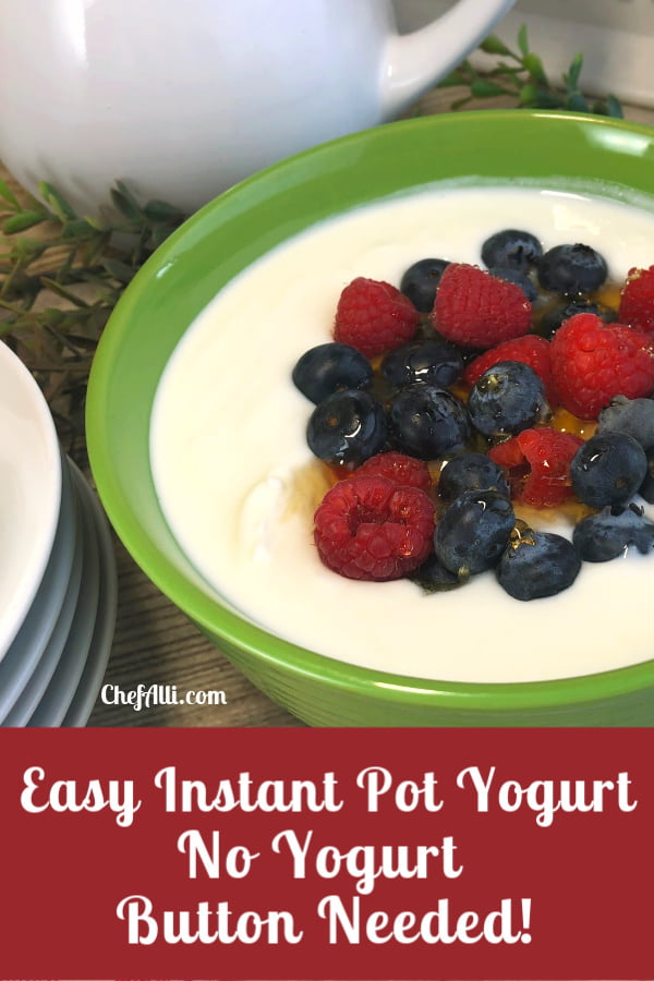 green bowl of yogurt topped with berries and honey.
