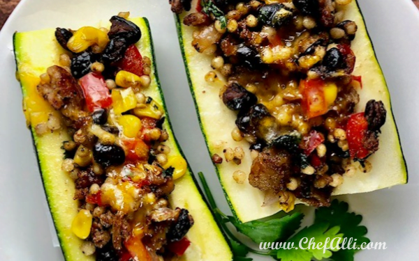 Low-Carb Mexican Zucchini Boats are packed with your favorite Mexican flavors! Loaded with veggies, heart-healthy grains, and just a little heat, they are a low-carb must for this week's menu! #lowcarb #mexican #zucchiniboats