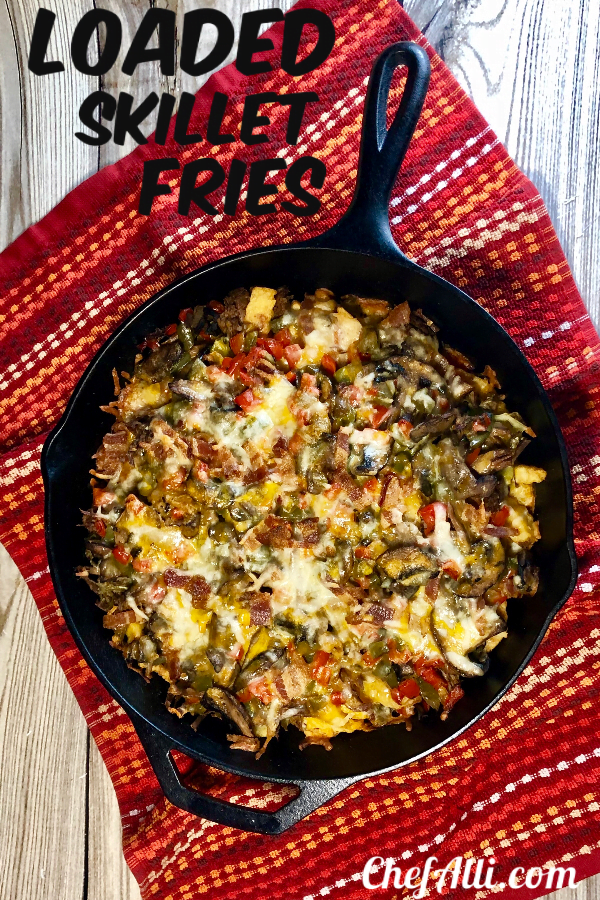 Who doesn't love a big ole skillet of loaded cheese fries?? Nobody, that's who. TheseLoaded Skillet Fries with Beef and Baconare topped with gooey cheese, tender shredded beef, and crispy bacon to make the perfect party appetizer recipe, all layered up and baked in my favorite Lodge cast iron skillet.