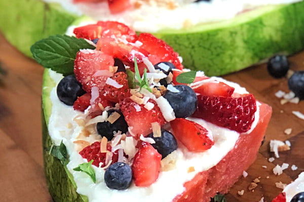 Nothing says summertime like a slice of Watermelon Dessert Pizza.  This easy, low-carb treat is a breeze to make and looks so refreshing when you add the berries and mint.  When hot days call for a refreshing, cool and healthy dessert, you'll have the perfect solution.