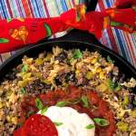 My guys love this one-pan Tex Mex Beef and Rice Casserole meal! I love having another recipe that turns ground beef into a tastmasterpiece that's easy, flavorful, and fast. I made this in my cast iron skillet, but it also works great baked in a casserole dish. #TexMex #GroundBeef #EatBeef #BeefAndRice #Easy #Fast #SkilletMeal #OnePanMeal