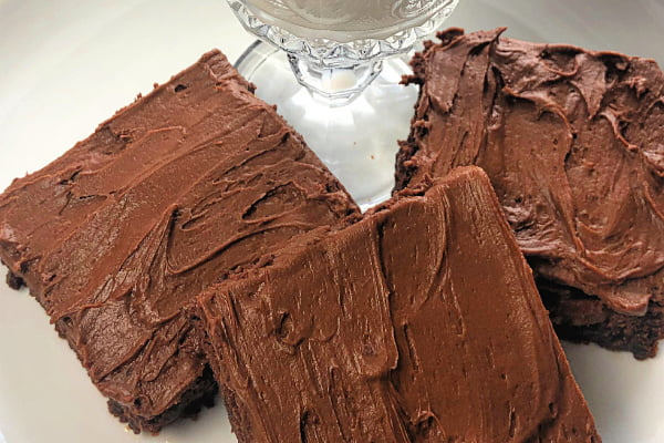 Are you a chocolate lover? Then you need to know about these Ridiculous Chocolate Brownies? Dark, rich, and luscious....these brownies should be considered one of the seven wonders of the world! This recipe makes a giant pan of brownies and get ready for a serious sugar rush - these are just delicious! #brownies #chocolate #darkchocolate