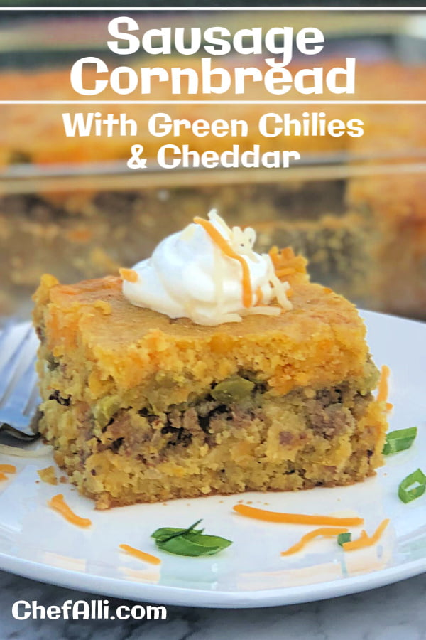 Now's the perfect time to bake up a fresh batch of Cheddar and Green Chili Sausage Cornbread! How do I know? Because it's loaded with layers of moist, dense cornbread, melted cheddar, mild green chilies, and cooked crumbled sausage. Serve topped with sour cream and sliced scallions, this is the perfect side dish for most any soup or chowder. #cornbread #cheddar #greenchilies #sausage #sidedish #soup #chowder #loaded #moist