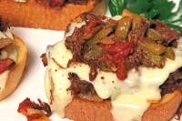 "Yay! Here's another easy weeknight dinner your family will go crazy for: Open-Face Italian Beef Sandwiches. This ground beef version of an Italian Classic is flavorful and fast - my guys gave them a giant ""thumbs up"", thankfully. These oven-baked sandwiches are also a big hit for watch parties on game day, as well.  #ItalianBeef #SubSandwiches  #OvenBaked  #GroundBeef #EatBeef #SpeedyMeal #Easy #Sandwiches"