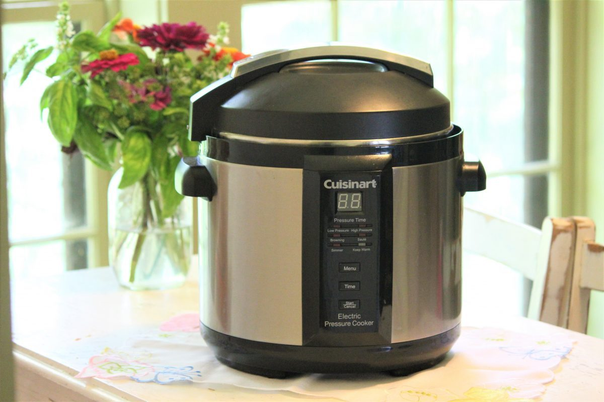 An Instant Pot electric pressure cooker sitting on the counter.