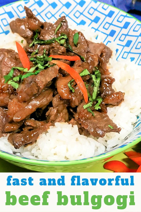 A bowl of white rice topped with warm Beef Bulgogi.