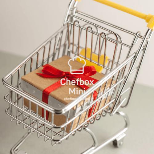 picture of a mini chefbox inside a mini shopping cart.