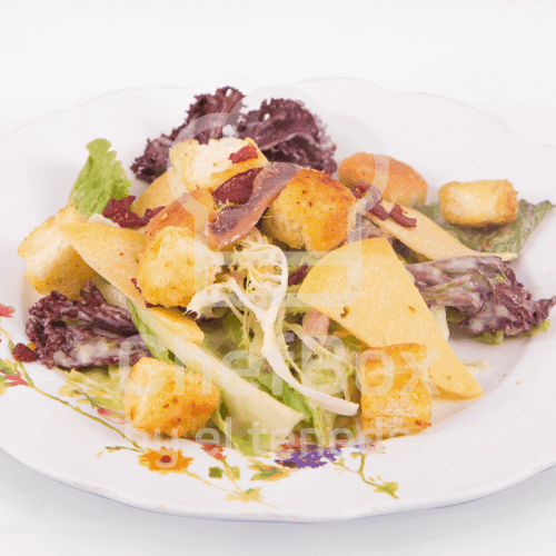 Lettuce, mayonnaise, anchovies caesar salad.