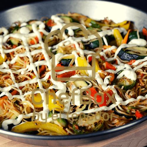 Roasted vegetable Spanish pasta paella with lines of aioli.