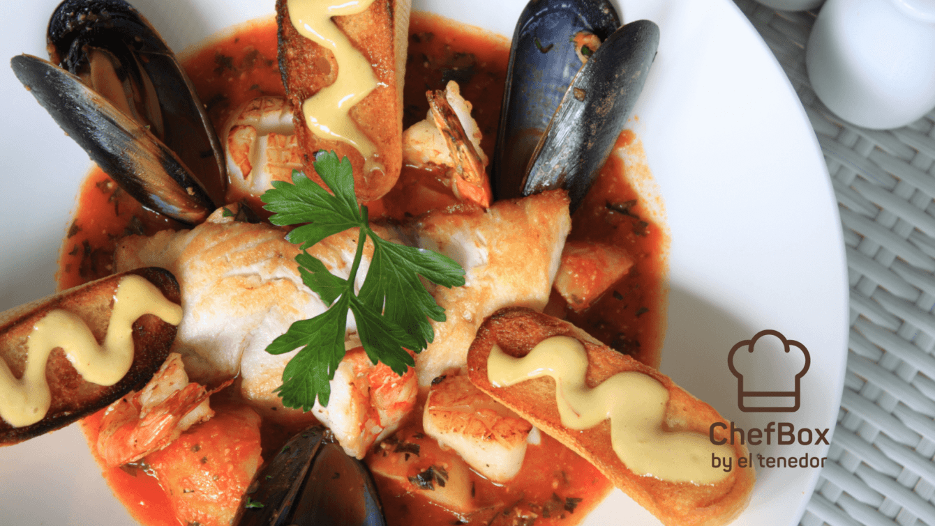 Seafood french soup in white plate.