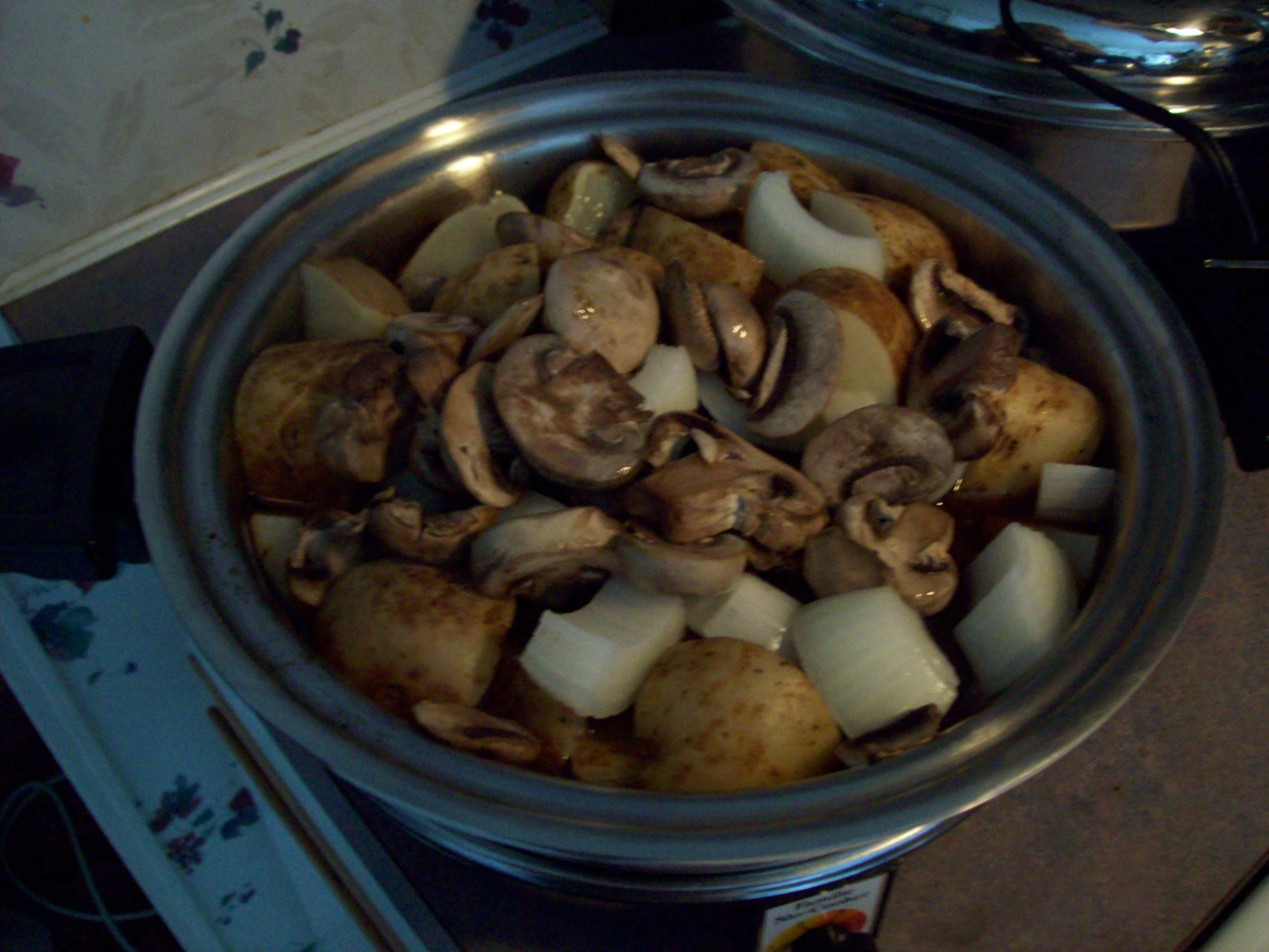 Roast, potatoes, onions, and mushrooms
