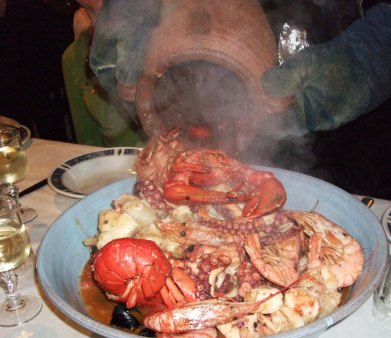 Seafood poured out of an amphora that was just inside a fire place, at a little hole-in-the-wall restaurant in monterosso, in cinque terre, italy. one of my most memorable meals ever!