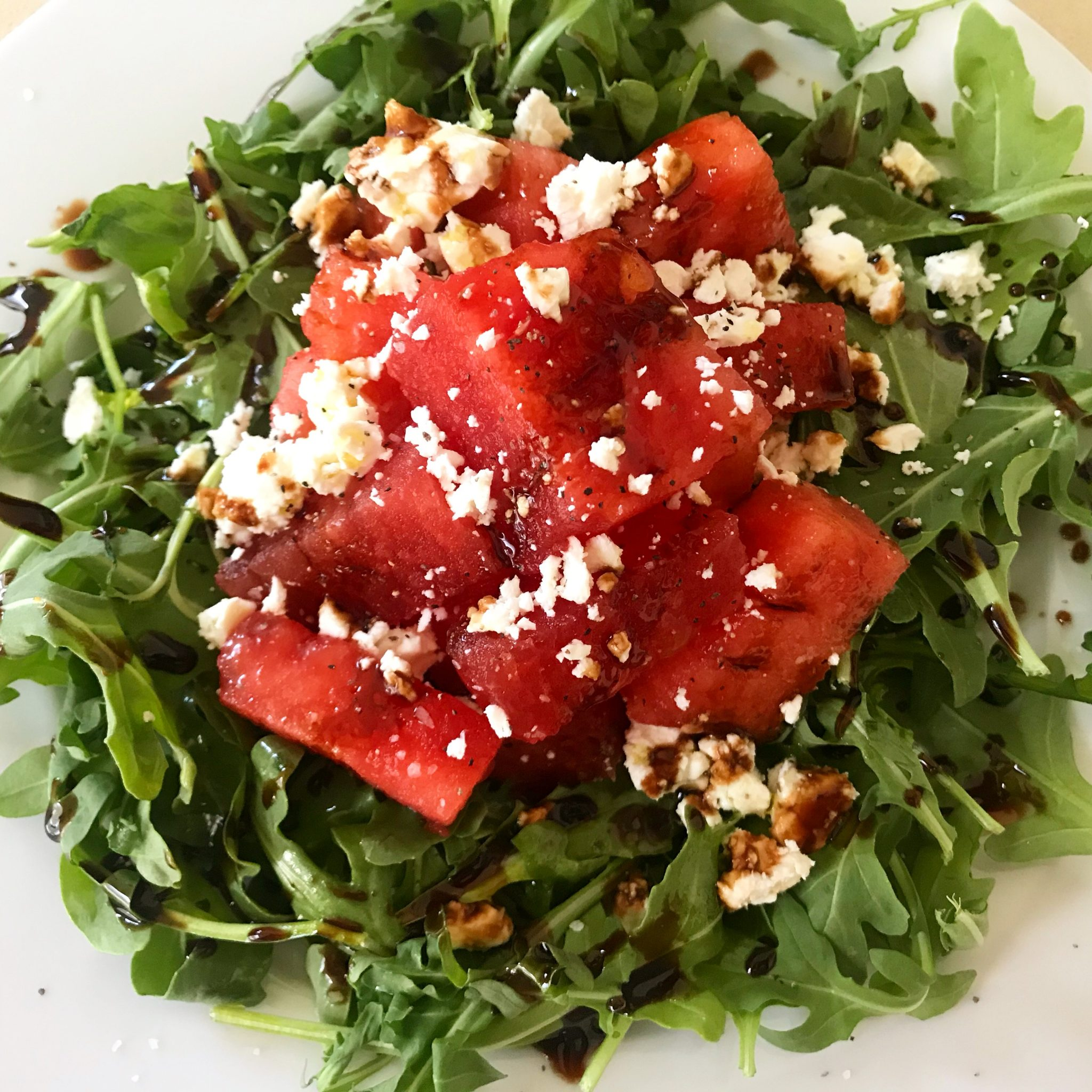 Arugula with Watermelon, Feta, and Pomegranate Molasses