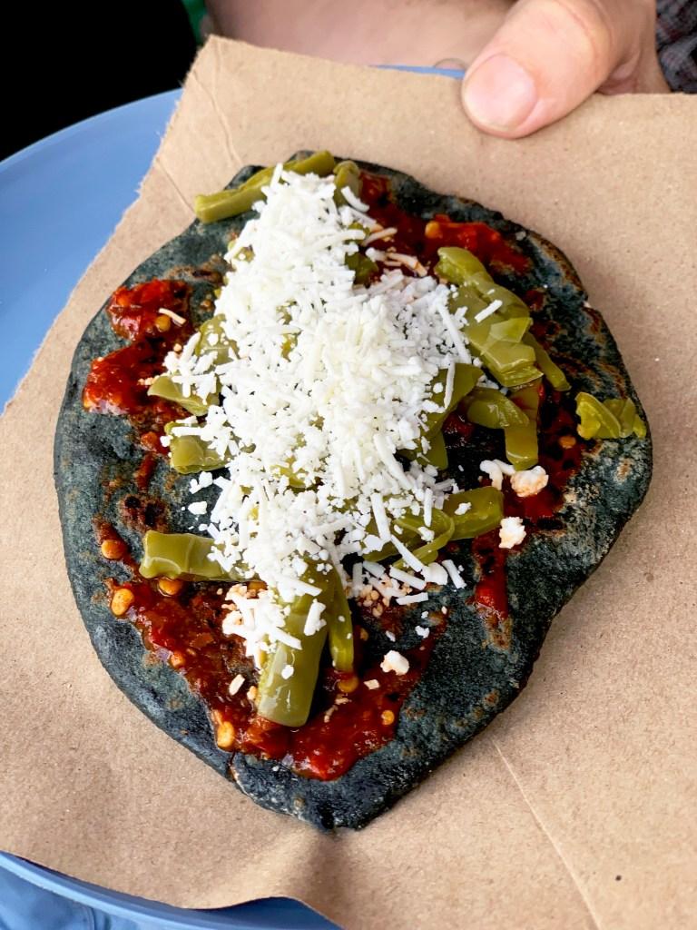 Tlacoyos requesón, beans, fava beans, nopales , cactus, chili sauce, blue corn masa