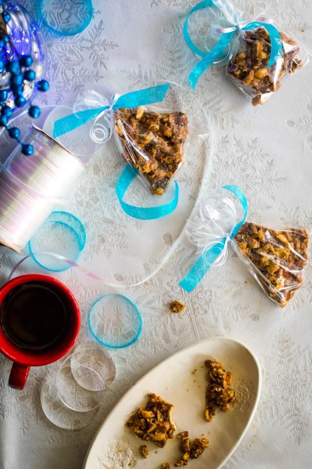 Flatlay nut brittle in gift bags. ChefSarahElizabeth.com