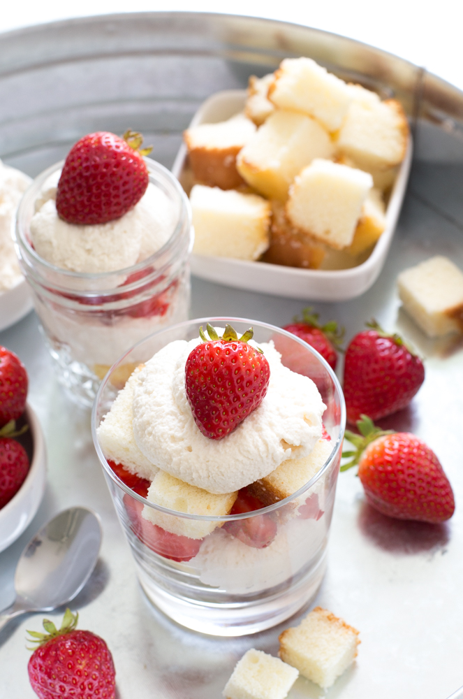 Top shot of strawberry and pound cake desserts on serving tray.