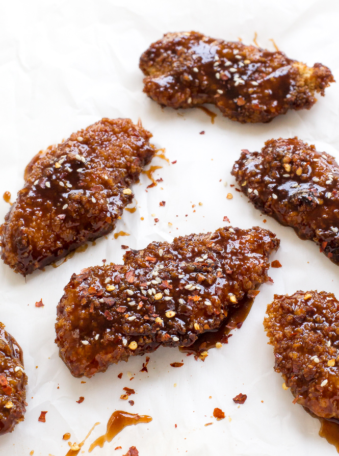 These Sweet and Spicy Asian Chicken Tenders are baked untilgolden brown then tossed in a sticky Asian sauce. Serve with rice and veggies!