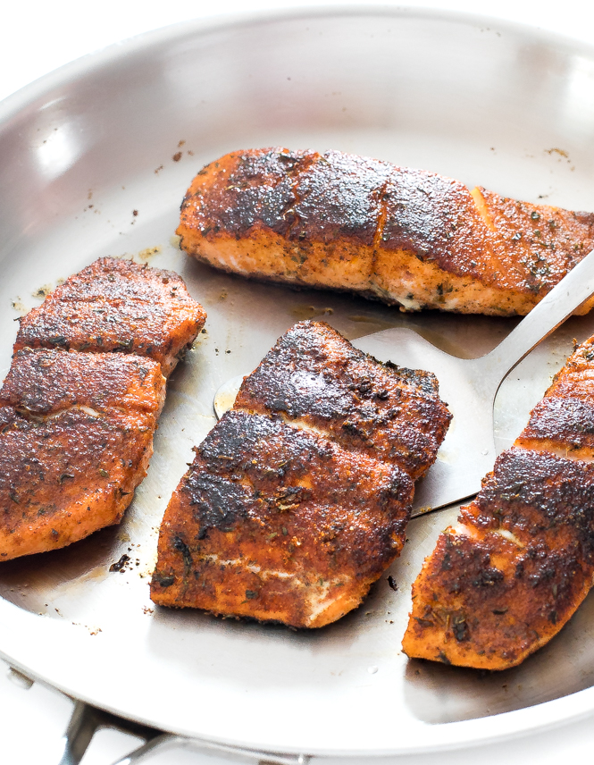 Searing blackened cajun salmon in a hot pan | chefsavvy.com