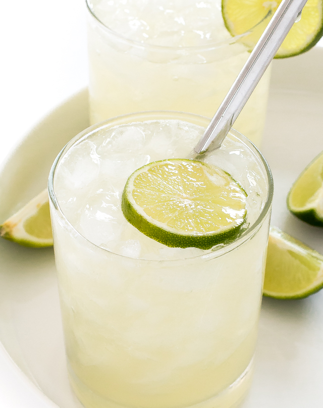 Margaritas with ice on a white serving tray