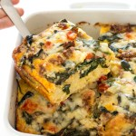 slice of breakfast casserole being lifted out of baking dish