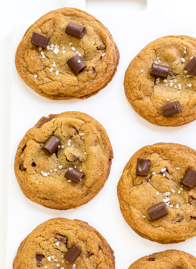 six chocolate chunk cookies on white plate