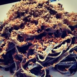 A quick meal at home; squid ink tagliatelle, bottraga, Ravida olive oil.